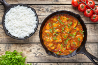 Traditional tikka masala chicken spicy meat Indian food with rice